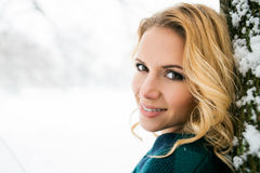 Smiling face of blond woman outside in winter nature Stock Images