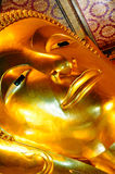 Smiling Face of Buddha. In the church of Wat Pho temple, Bangkok, Thailand Stock Image