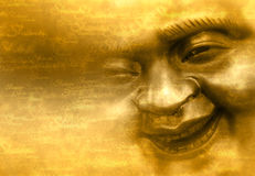 Smiling face of Buddha. On grunge yellow background with repeated word shanti Royalty Free Stock Photo