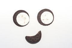 Smiling face chocolate cream biscuit Royalty Free Stock Photography