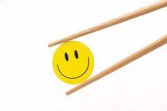 Smiling face chopsticks Royalty Free Stock Photography
