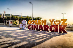 Smiling Face Of Cinarcik Logo In Town Square. The positive tag line that describes the small summer town named Cinarcik located in Marmara region of the country royalty free stock photo