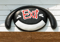 Smiling face with exit sign Stock Photography