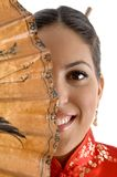 Smiling face of female covered with umbrella Royalty Free Stock Photography