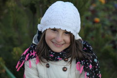 Smiling face. Girl with white cap smiling royalty free stock photography