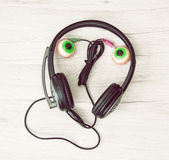 Smiling face of headphones and chewing gums. Funny concept Royalty Free Stock Image