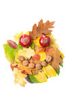 Smiling face made of autumn fall leaves and fall decorations Royalty Free Stock Photo