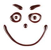 Smiling face made of chocolate syrup Royalty Free Stock Photo