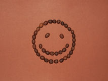 Smiling face made of coffee beans Stock Photography