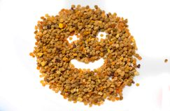 Smiling face made of pollen granules-natural and health.comercial.  stock photos