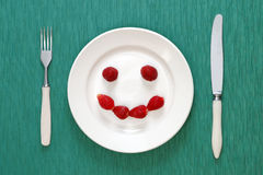 Smiling face made of strawberries Royalty Free Stock Photos