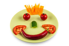 Smiling face made of vegetables Stock Photos