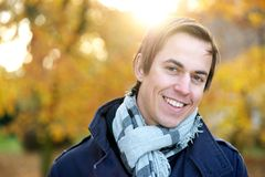 Smiling face of a male fashion model posing outdoors Royalty Free Stock Photo