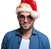 Smiling face of a man in santa claus hat Stock Photo