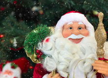 Smiling face of a New Year`s Santa Claus, snowing Stock Photo