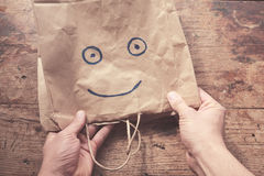 Smiling face on paperbag Stock Photos
