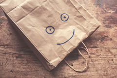 Smiling face on paperbag Royalty Free Stock Images