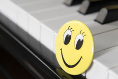 Smiling face. On the piano Stock Image