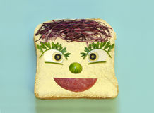 Smiling face on slice of bread Stock Photo