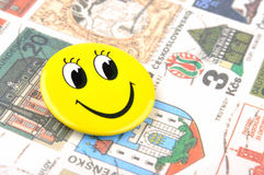 Smiling face and stamps. Smling face and stamps of different countries, means happy travel and world wide communication Royalty Free Stock Photography