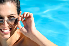 Smiling face in swimming pool. Woman with beautiful smile enjoys summer in pool Stock Photo