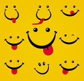 Smiling face with tongue on yellow background. Stock Images