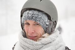 Smiling face of woman, wet snowy skin, cold winter outdoor, snow storm Stock Photography
