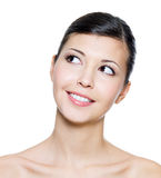Smiling face of an young adult woman looking up Stock Images