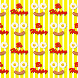 Smiling facer make with fried eggs and sausage seamless pattern Royalty Free Stock Photos