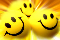 Smiling faces. Three smiling faces on bright background Stock Photos