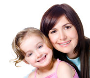 Smiling faces of mother with daughter stock photos