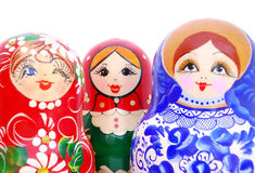 Smiling faces of Russian dolls Stock Photo