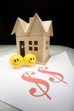 Smiling faces with Small House Stock Photography