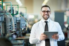 Smiling  Factory Worker  Holding  Tablet royalty free stock image