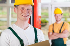 Smiling factory worker Stock Photos