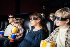 Smiling Families Watching 3D Movie In Theater Stock Photo