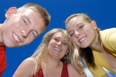 Smiling family. Brother sister and their mother Royalty Free Stock Images