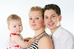 Smiling family. Young happy loving family with the baby Royalty Free Stock Photo