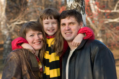 Smiling Family. Father, mother and daughter Stock Photo