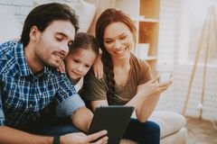 Smiling Family in Apartment with Bright Interior. stock photos