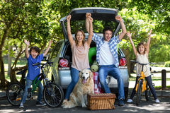 Smiling family with arms up Stock Photo