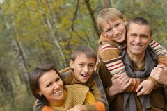 Smiling family in autumn forest Royalty Free Stock Photography