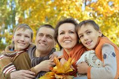 smiling family in autumn forest Royalty Free Stock Images