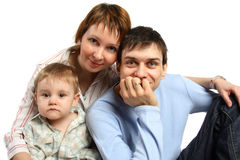 Smiling family: baby, man, woman Royalty Free Stock Photo