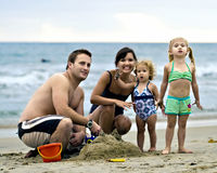 Smiling Family on Beach. Portrait of a family of 4 smiling on the beach Royalty Free Stock Photos