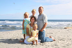 Smiling Family on the Beach. A happy family of 5 taking a portrait on the beach Stock Photography
