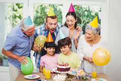 Smiling family during birthday party Stock Photo
