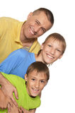 Smiling family in bright T-shirts Royalty Free Stock Photos
