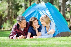 Smiling Family Camping In Park Stock Photos