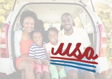 Smiling family in the car boot for the 4th of July royalty free stock photo